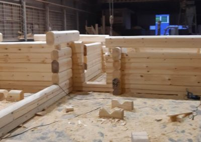 Building Log Cabin in Factory